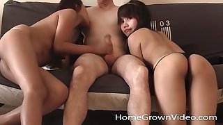Two petite Asian amateurs codification a colourless cock