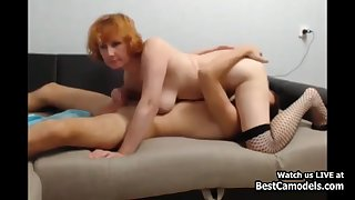 Horny Redhead Cougar Fucks Schoolboy On Couch